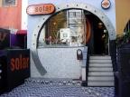 a loja antiga com o rôbo solar e pintura pscicodélica